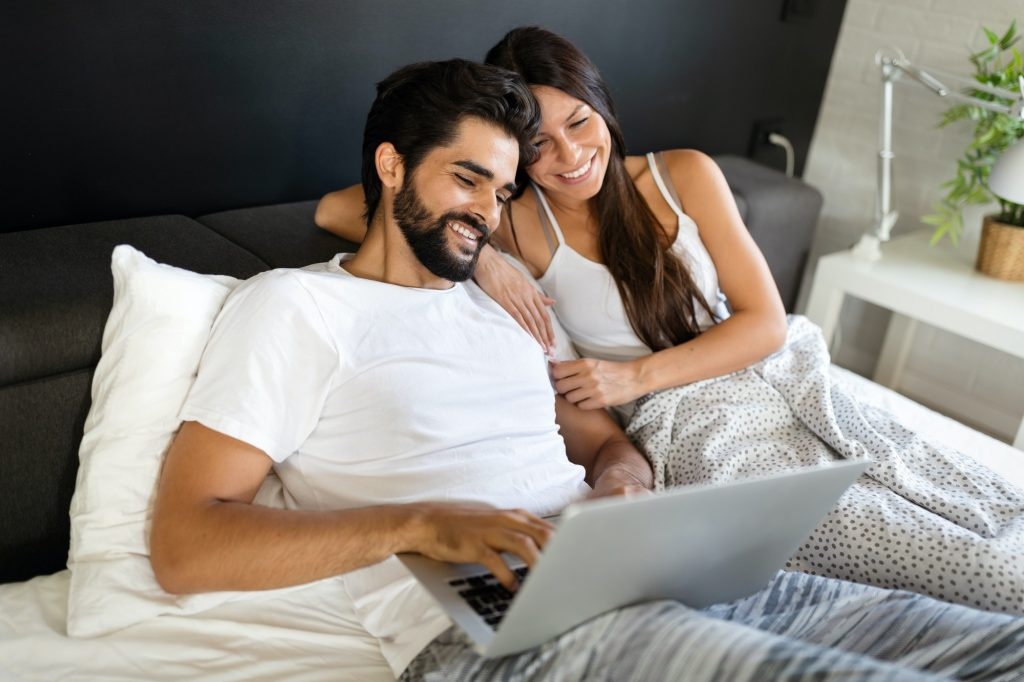 Couple enjoying online gaming